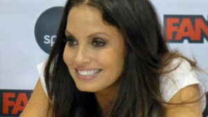 Trish Stratus Reveals Husband's Response To Her Kissing The Rock